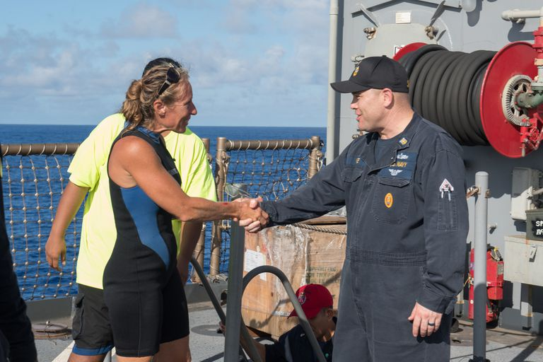 Command Master Chief Gary Wise welcomes Jennifer Appel aboard the USS Ashland