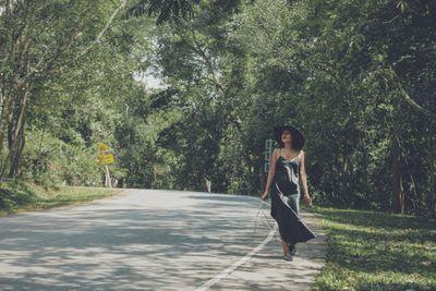 woman walking along road