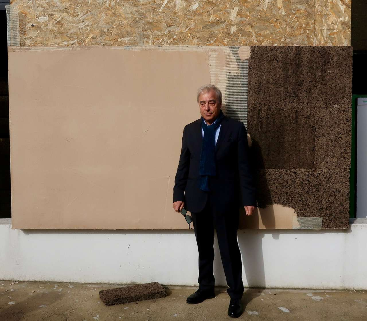 Carlos Manuel in front of wall