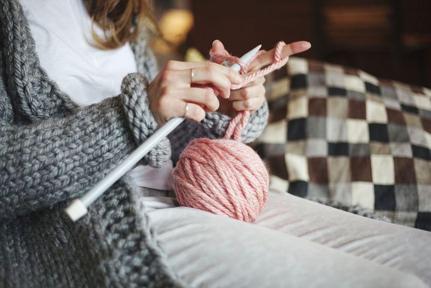 Woman Knitting Wool At Home