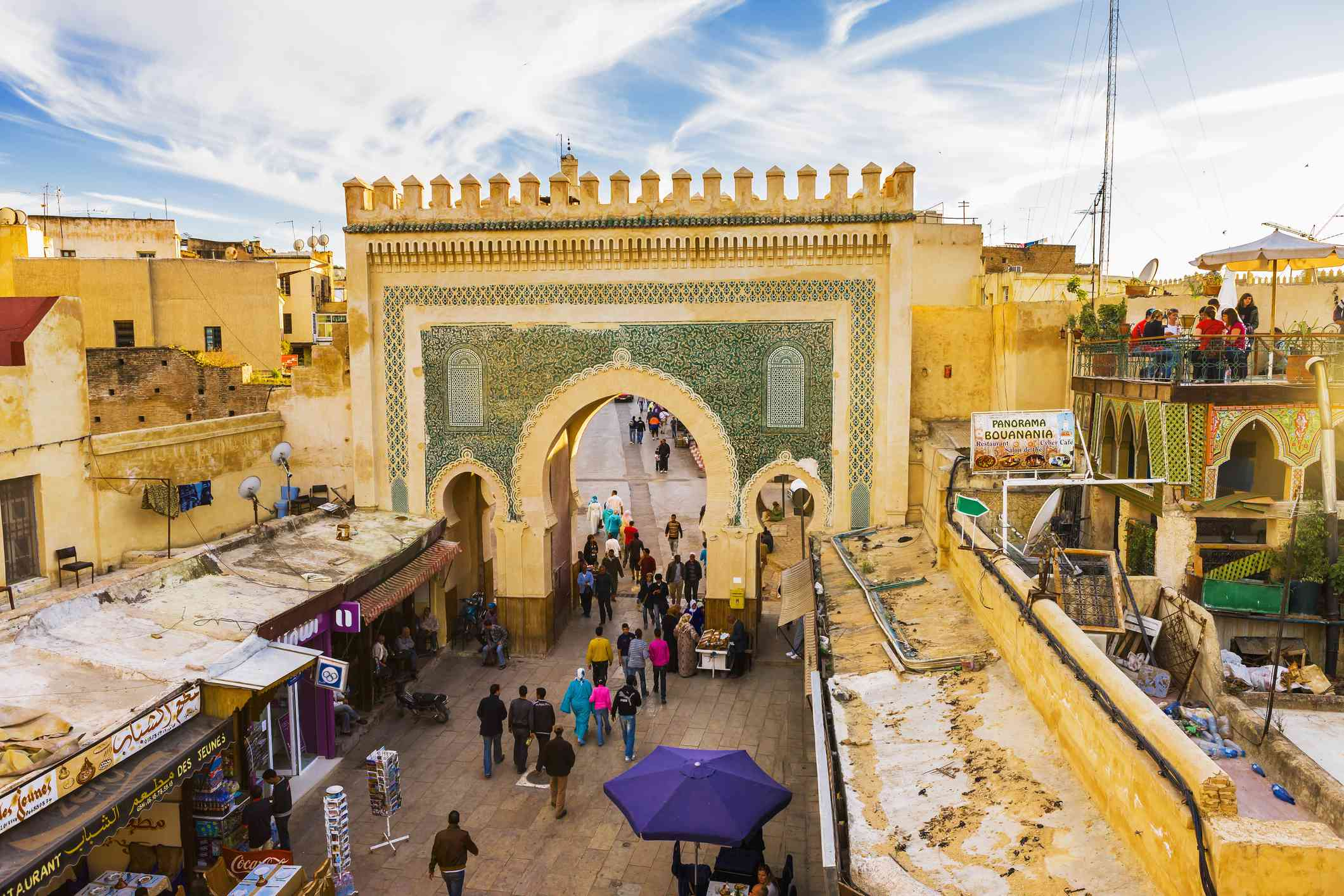 People walking through arch in Old Fez