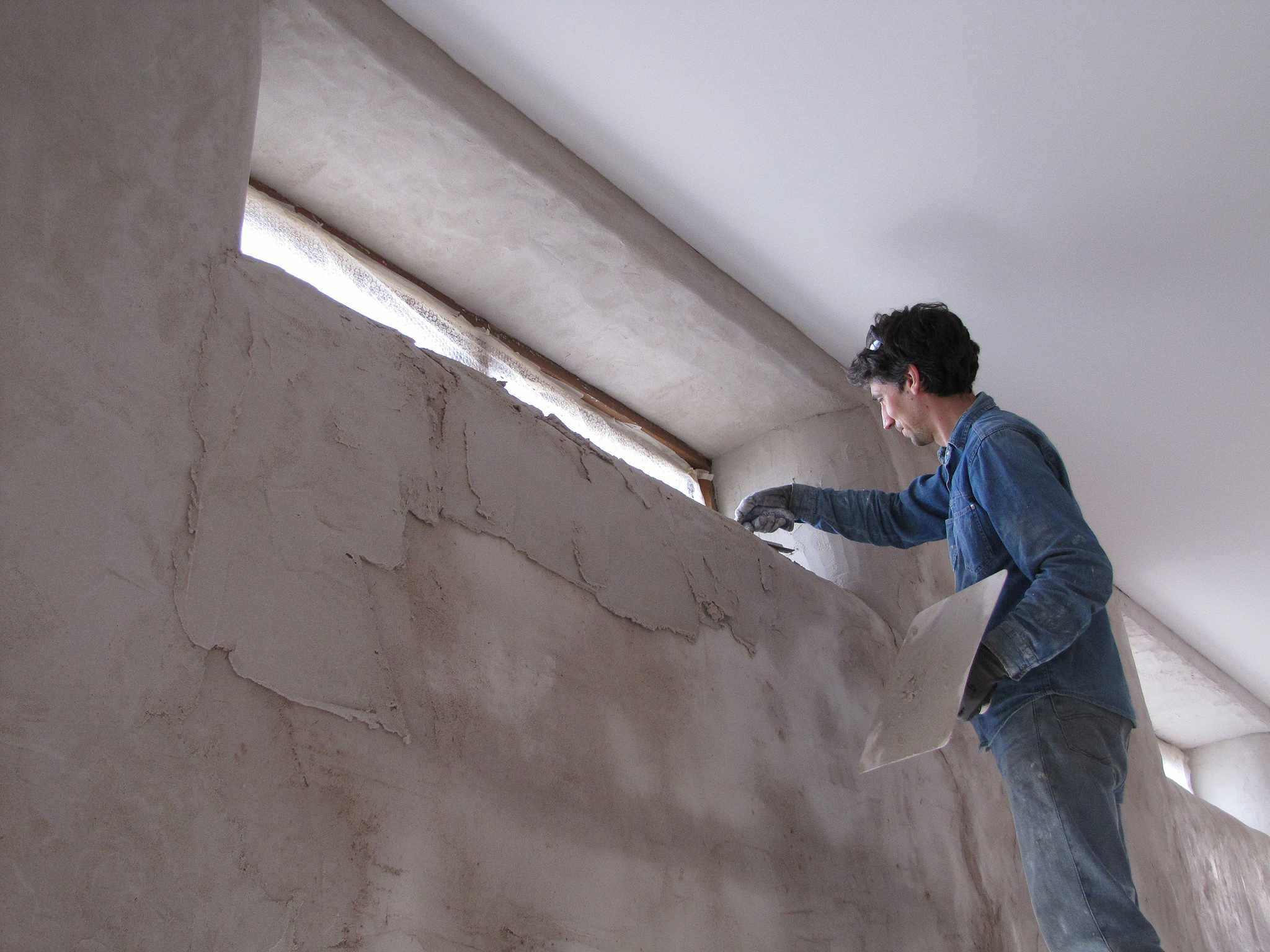 Man applying plaster to a wall