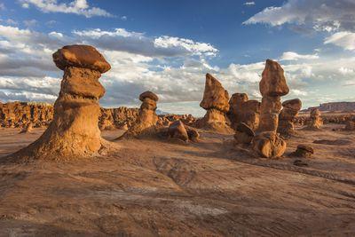 Hoodoos in dry landscape of Utah against blue sky