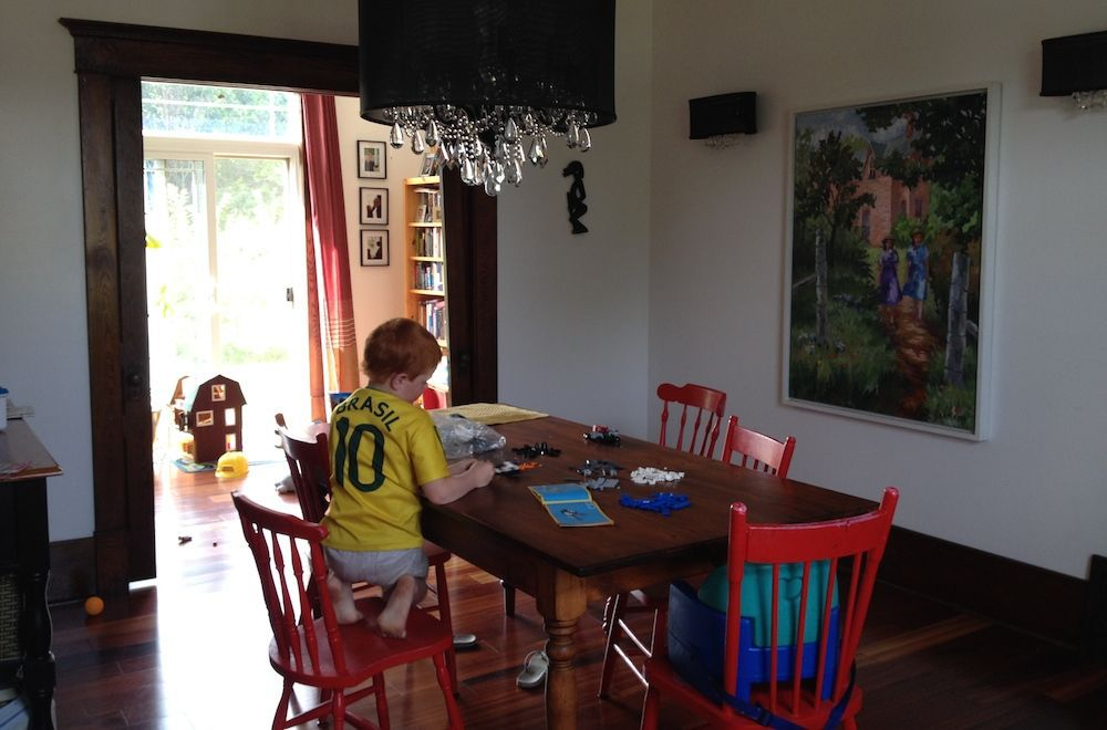 Child doing a project at the family dining room table