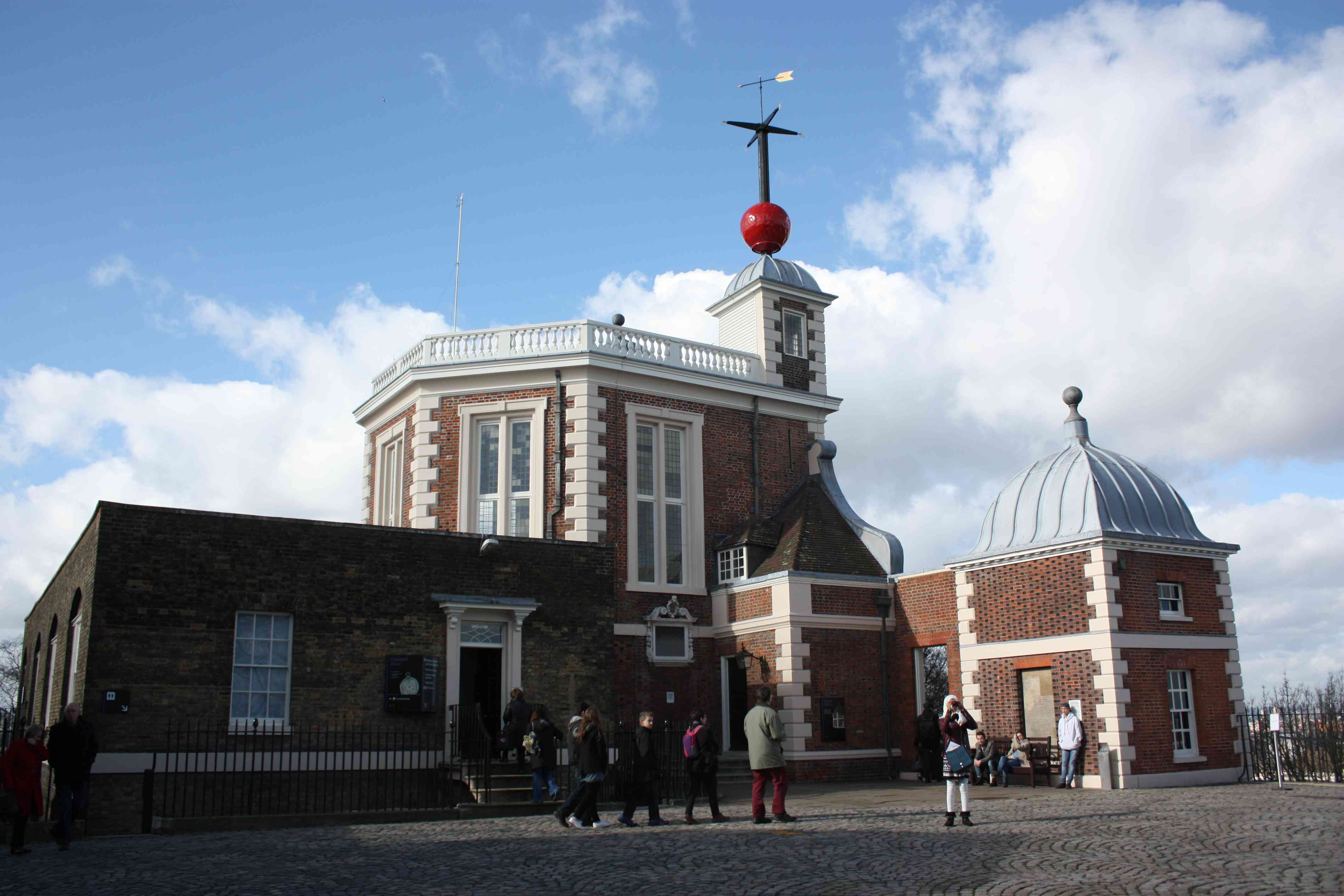 Tourists gather outside of the Royal Observatory, Greenwich in England