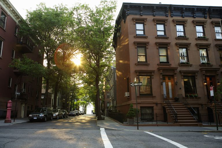 Brownstone street with trees.