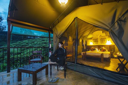 woman in front of a luxury tent
