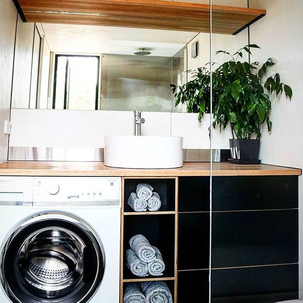 Laundry nook with washer, cupboards, and sink