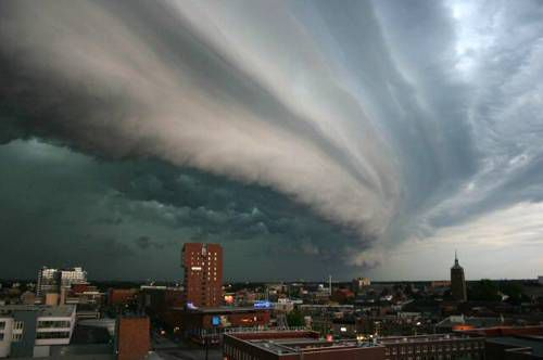 Cloud formation in the sky above a city