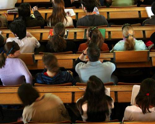 Students in a college classroom as seen from above