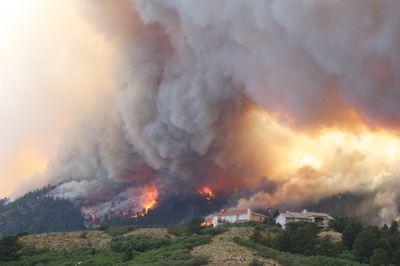 A wildfire burning near a Colorado