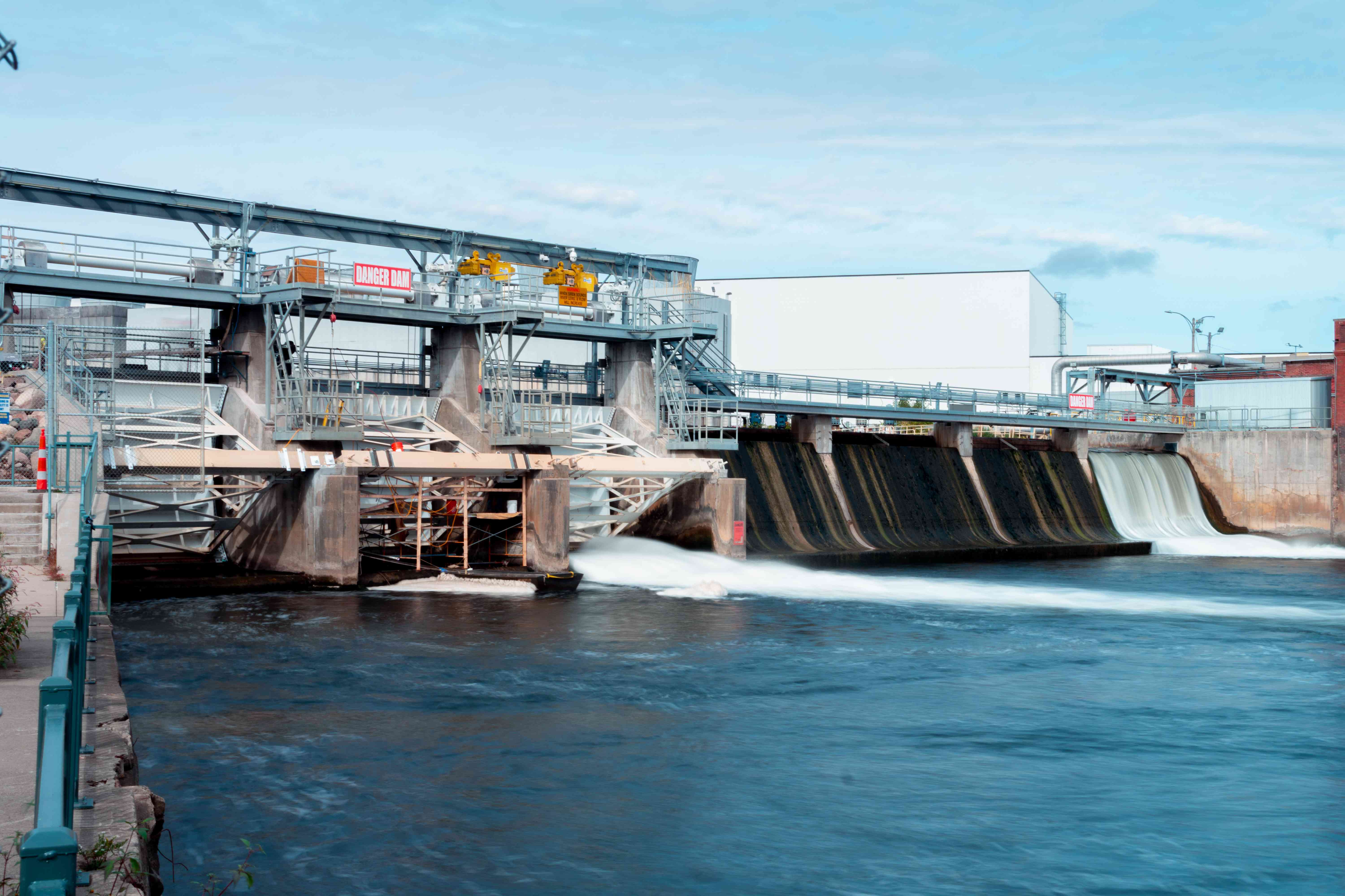 long shot of hydropower plant with dam
