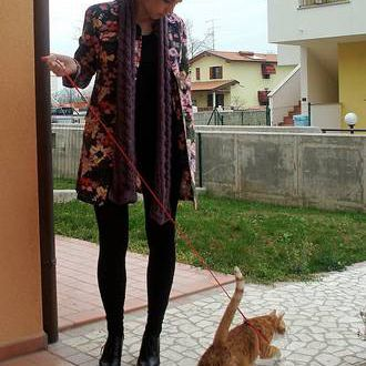Alyssa Young with cat, Leonardo, on a leash