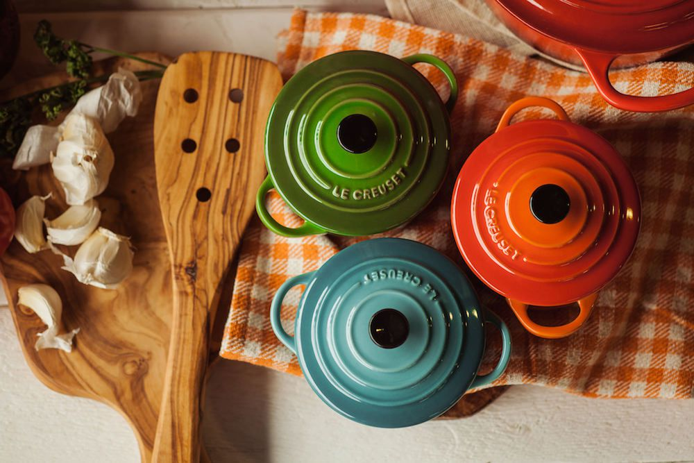 Creuset pots in assorted colors