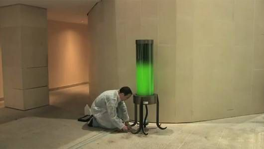 A microalgae lamp set up in a parking garage