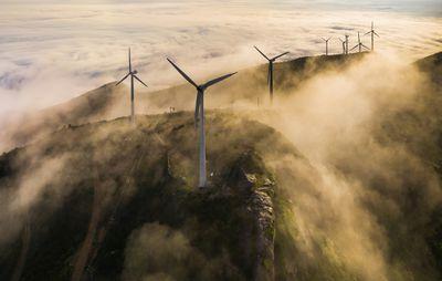 Wind turbines located on mountain ridges in the mist