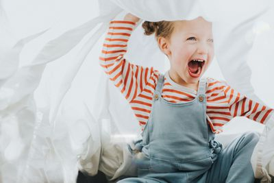 Girl playing with sheets