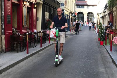 Older person on scooter in paris
