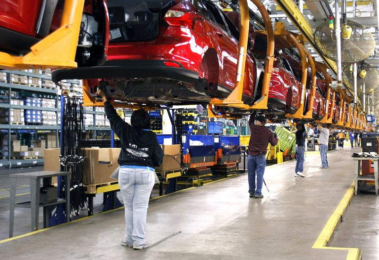 Workers build a Ford Focus on the assembly line at the Ford Motor Co.'s Michigan Assembly Plant December 14, 2011 in Wayne, Michigan.