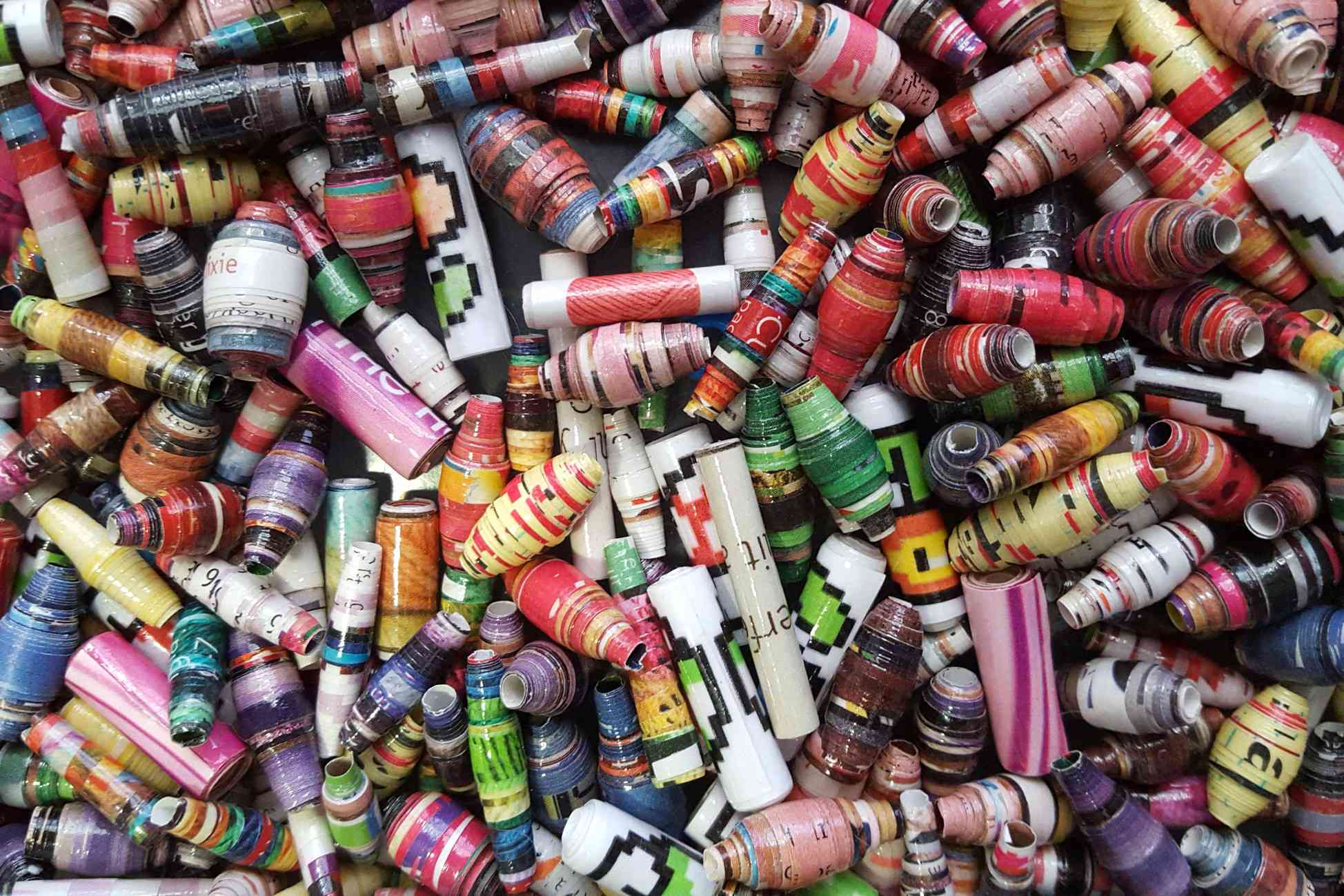 Pile of colorful paper beads of different shapes and sizes