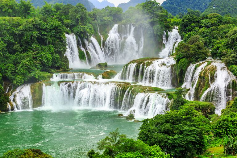 Waterfalls surrounded by lush greenery