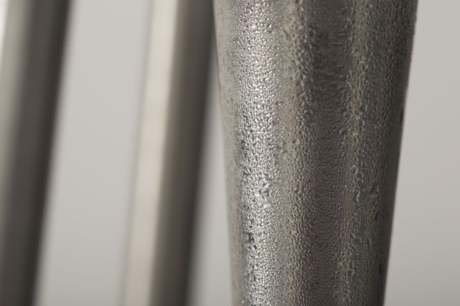 Close-up of tapered metal tube
