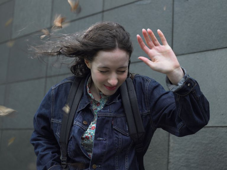 Woman caught up in wind