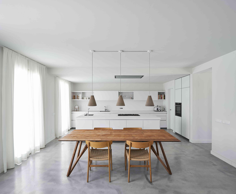 white minimalist kitchen with wood table
