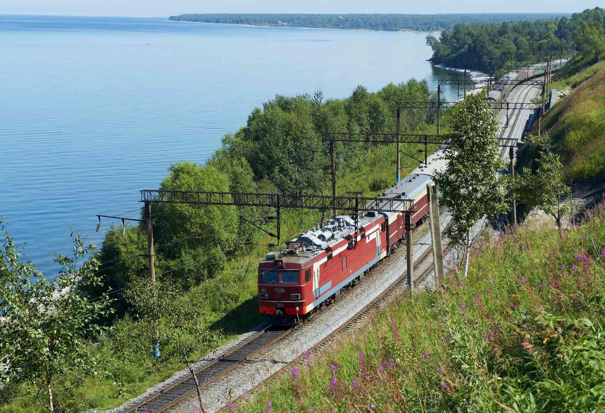 Trans-Siberian train running alongside Baikal Lake, Russia