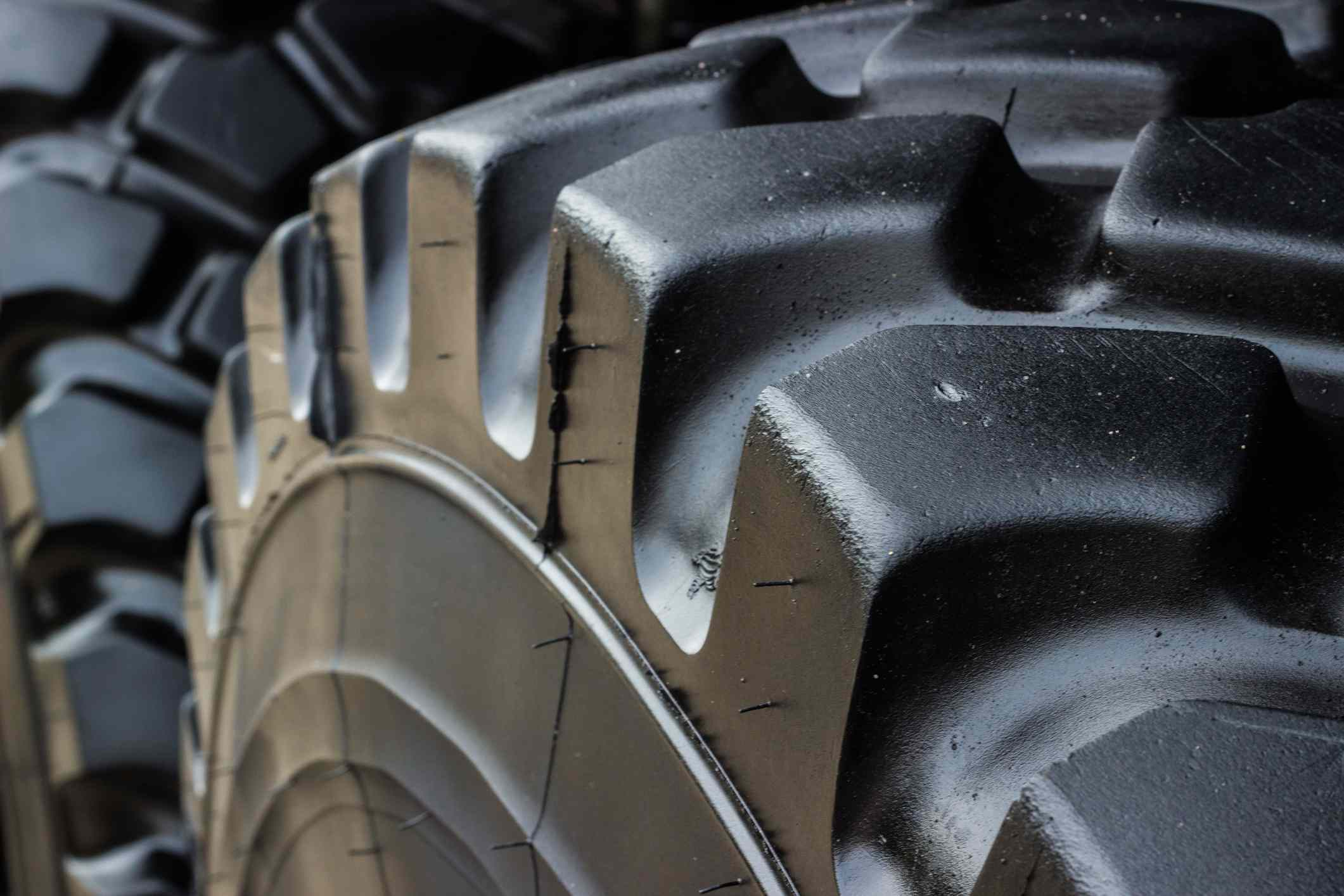 Close up of black rubber tires on military vehicle.