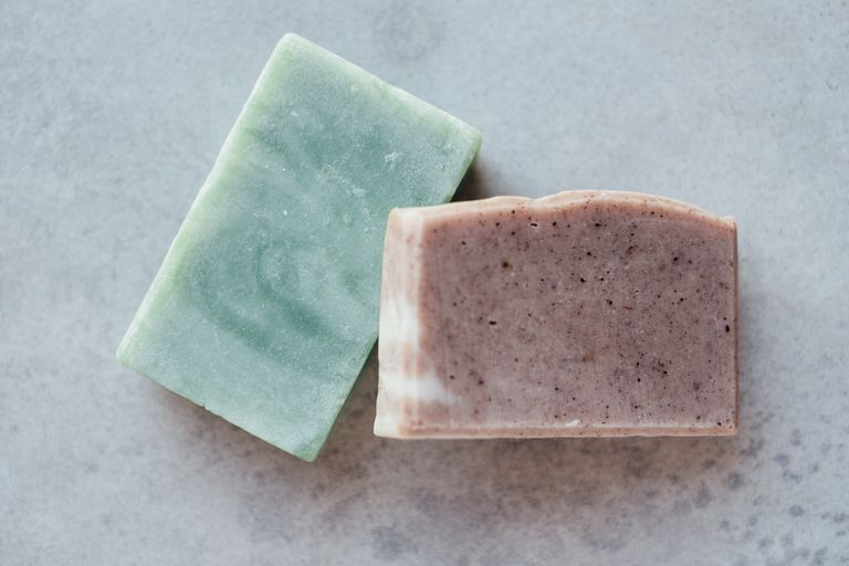One turquoise and one mauve colored bar of soap
