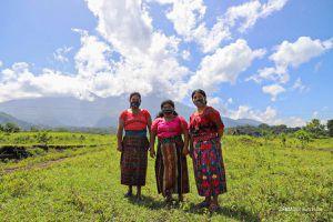 Three Indigenous women standing outside