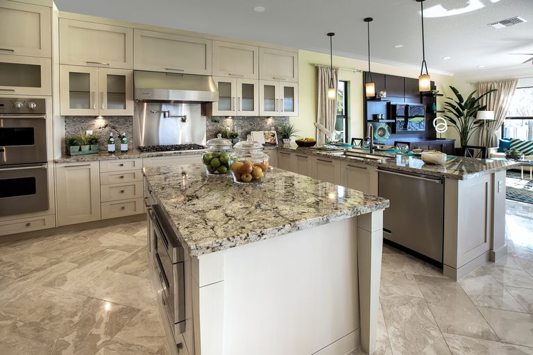 Kitchen featuring cream and gray marbled countertops on the counter and an island