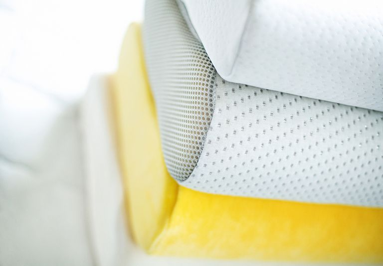 Memory foam pillows stacked on top of one another.