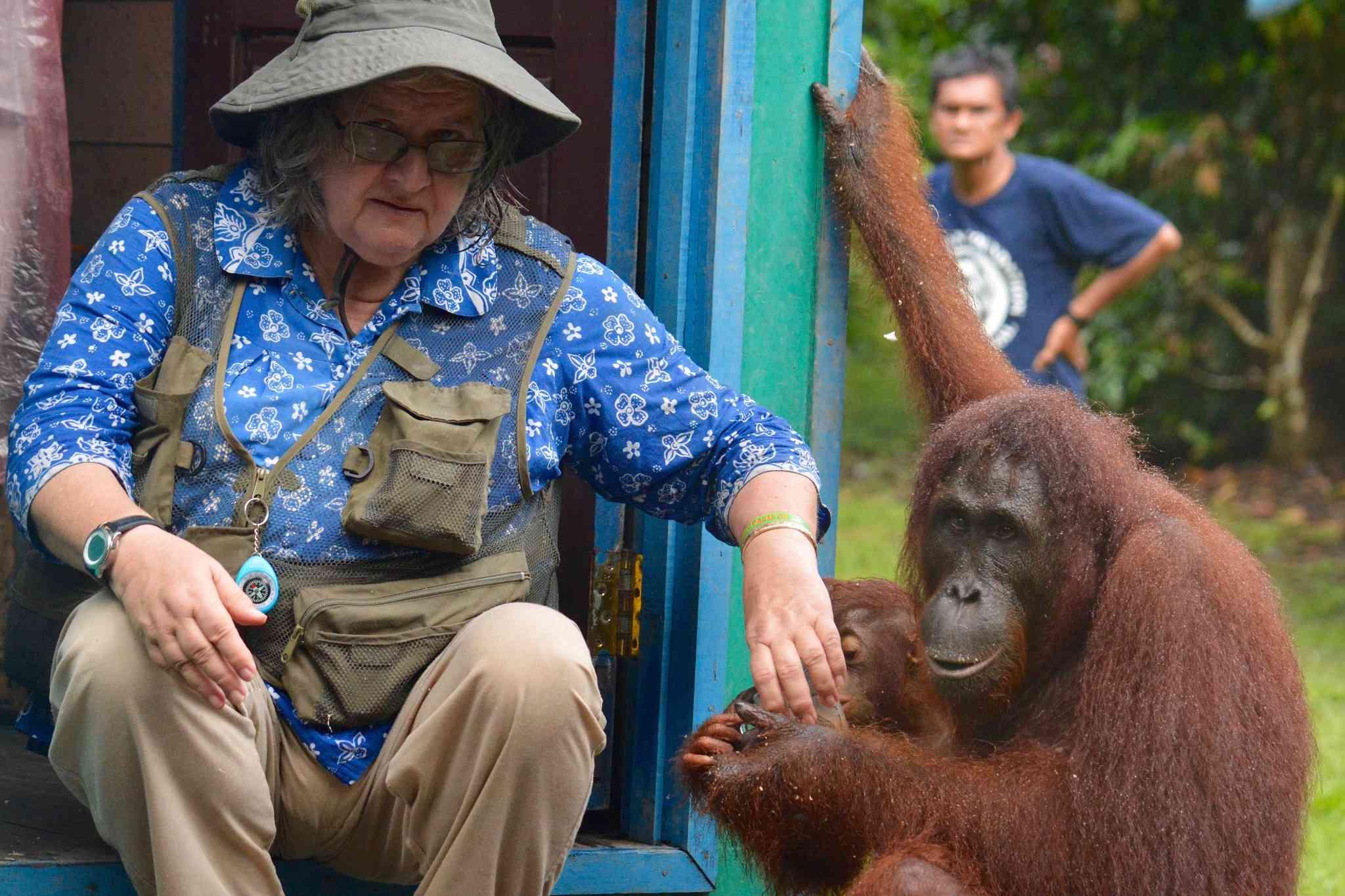 Birute Galdikas with an orangutan