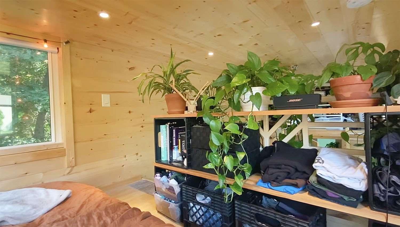 tiny house with houseplants bedroom shelf