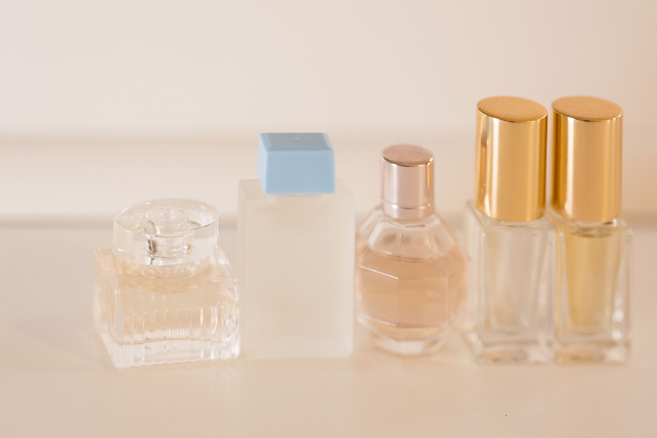 Perfume beauty sample bottles lined up on a table.