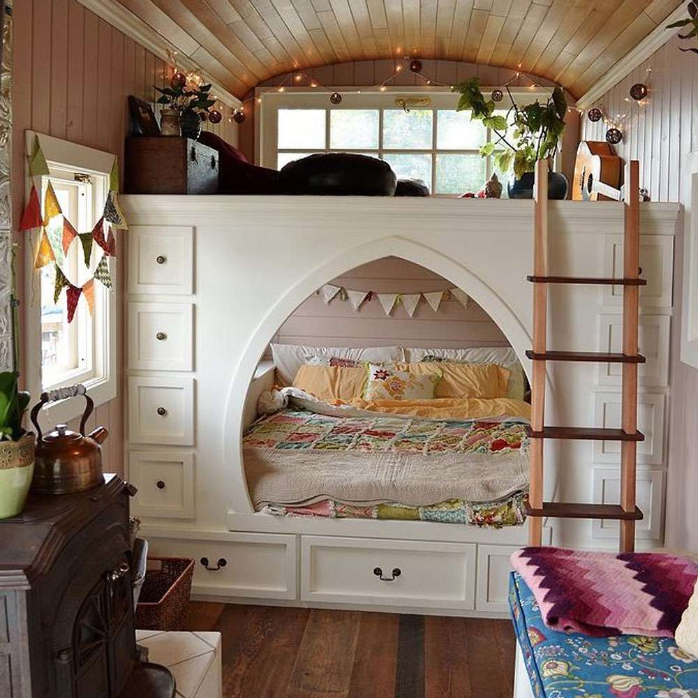 Bedroom in school bus converted tiny house