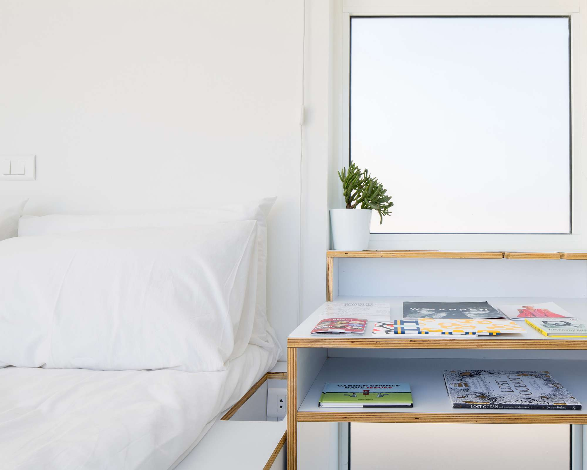 The Shoebox micro-apartment by Elie Metni bed