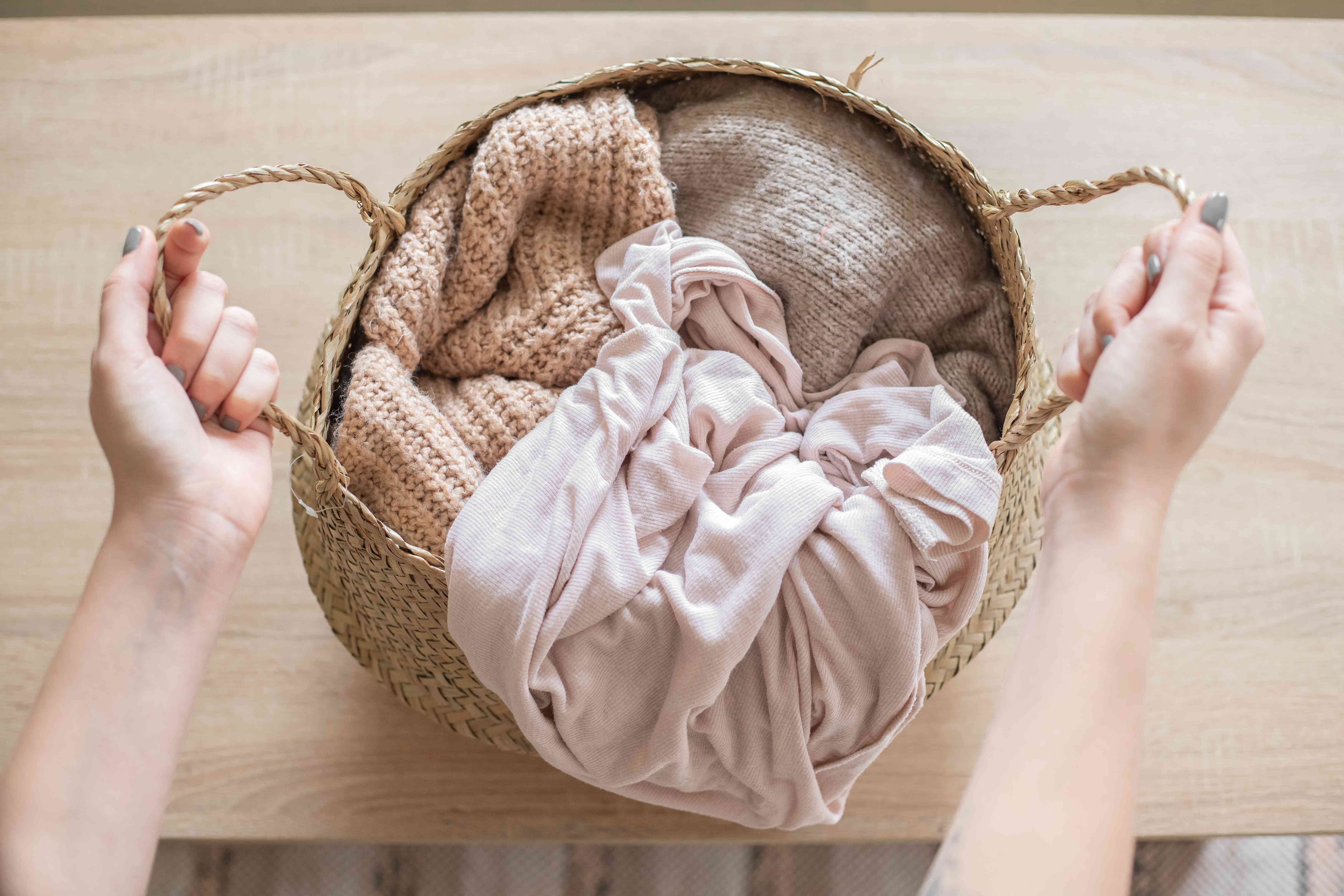 overhead shot of clothes in straw laundry basket
