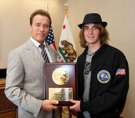 Governor Schwarzenegger presents solo sailor Zac Sunderland with an award