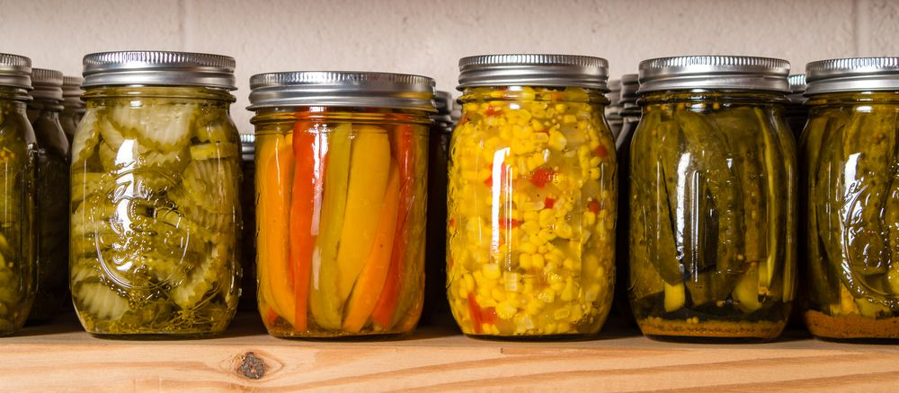 canned vegetables on a pantry shelf
