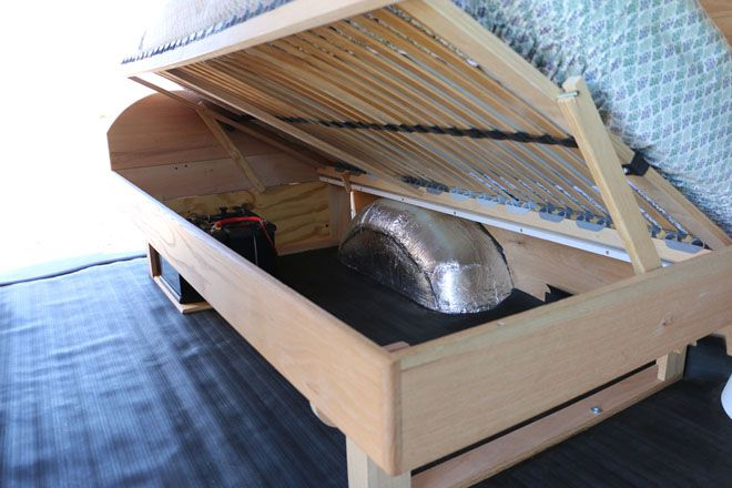 Bed raised to show storage space underneath