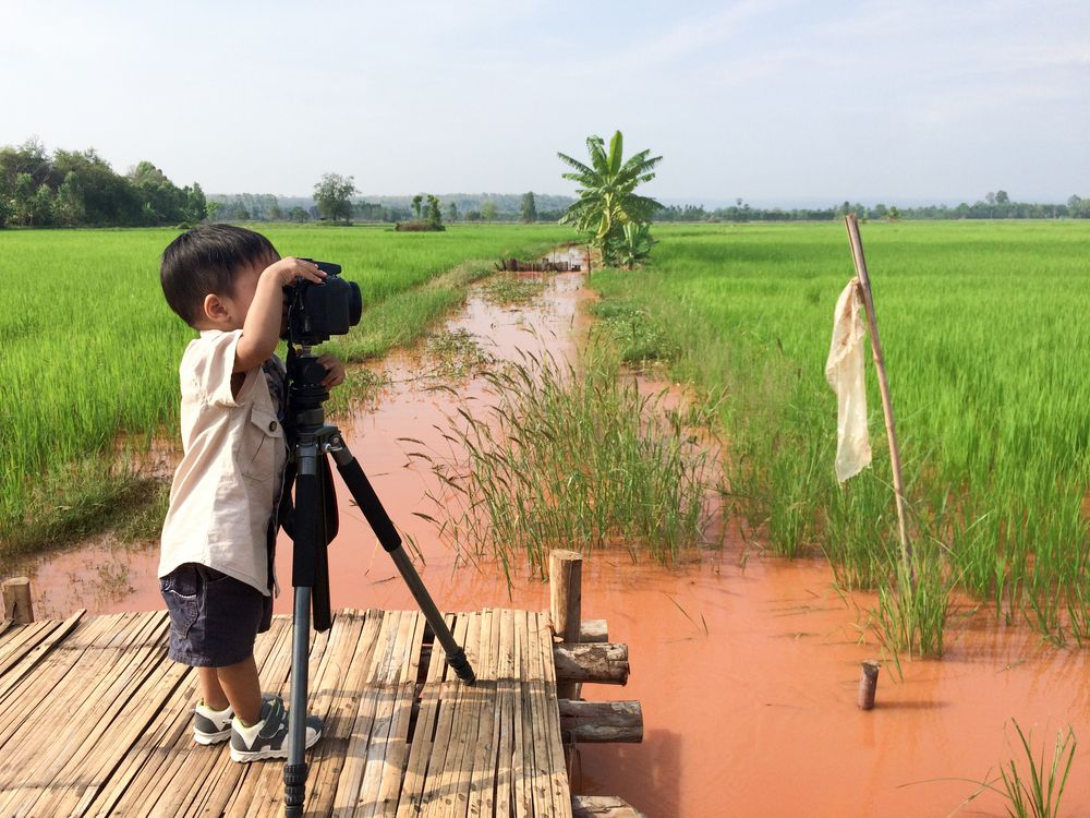 Step up to the tripod! Kids can start learning photography at any age.