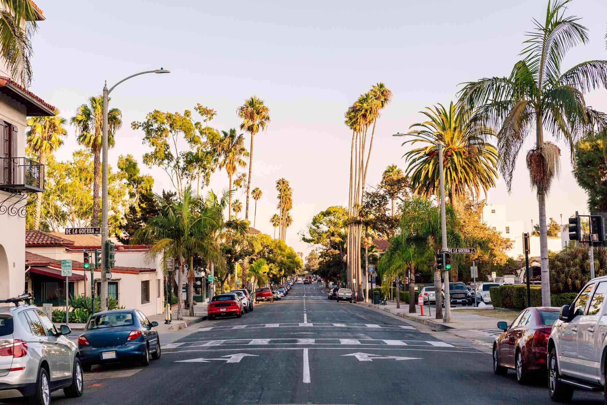 car-lined street in Santa Barbara while sun is setting