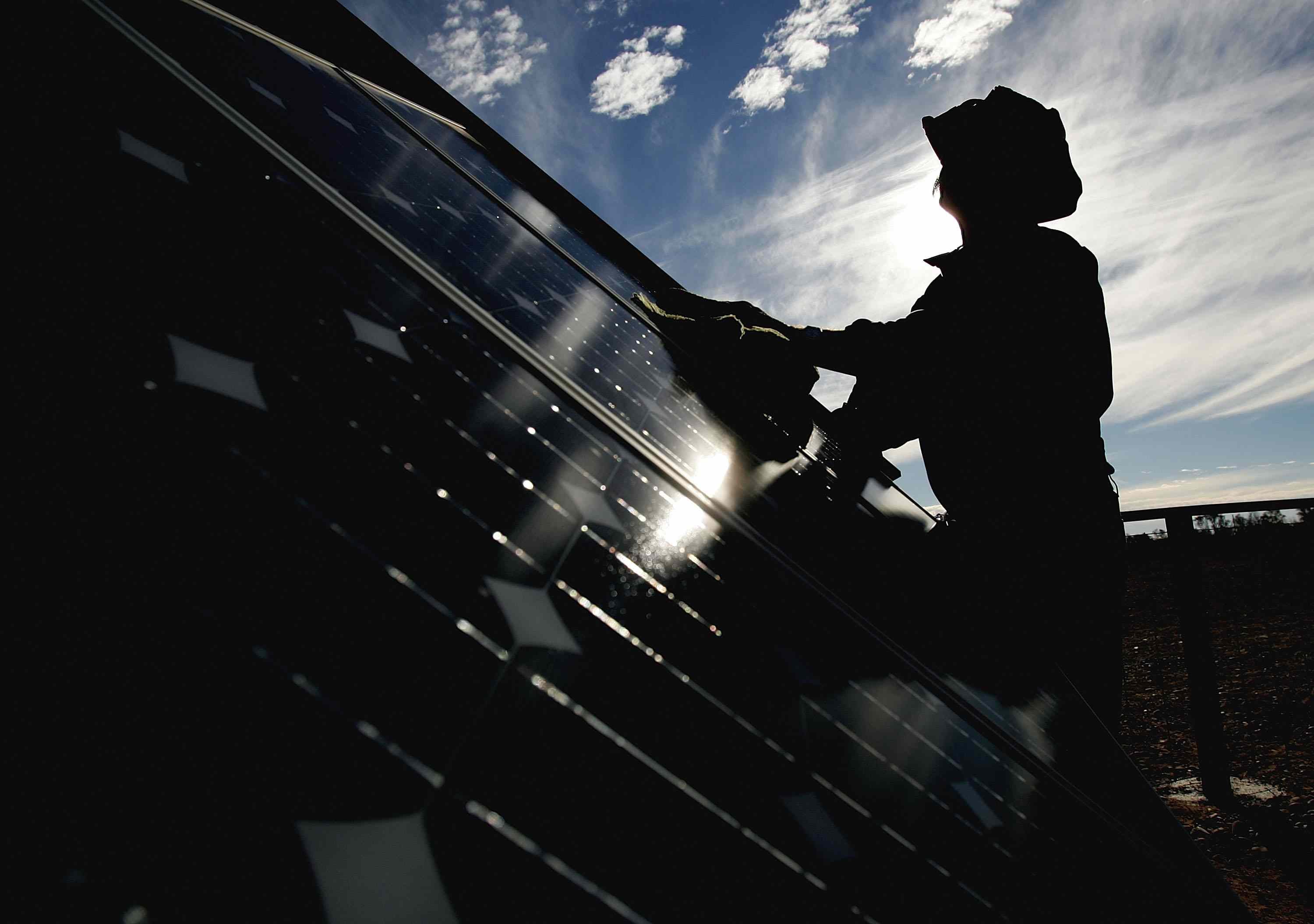 Person cleaning solar panels.