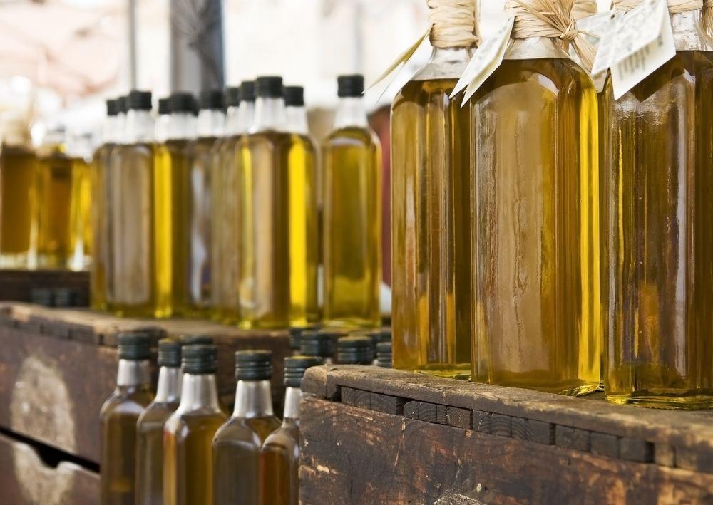 Bottles of olive oil on a shelf