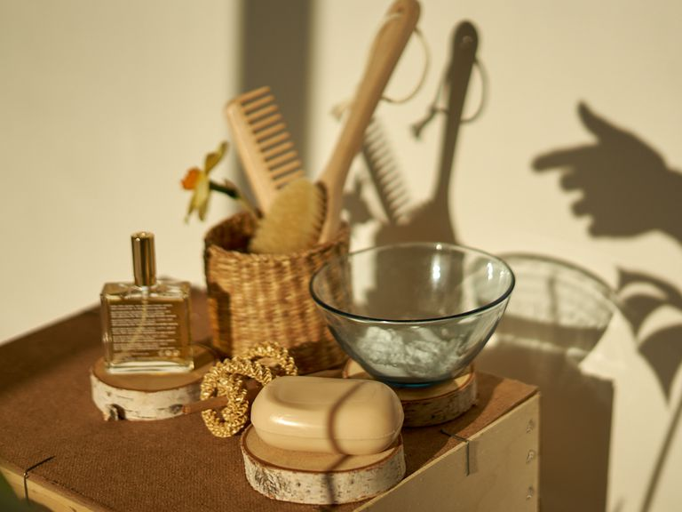 still life of zero waste beauty products, complete with wooden hair brushes and soap bar