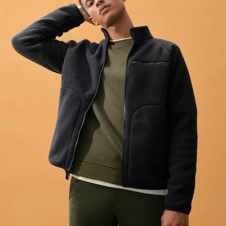 guy in black recycled fleece by Everlane