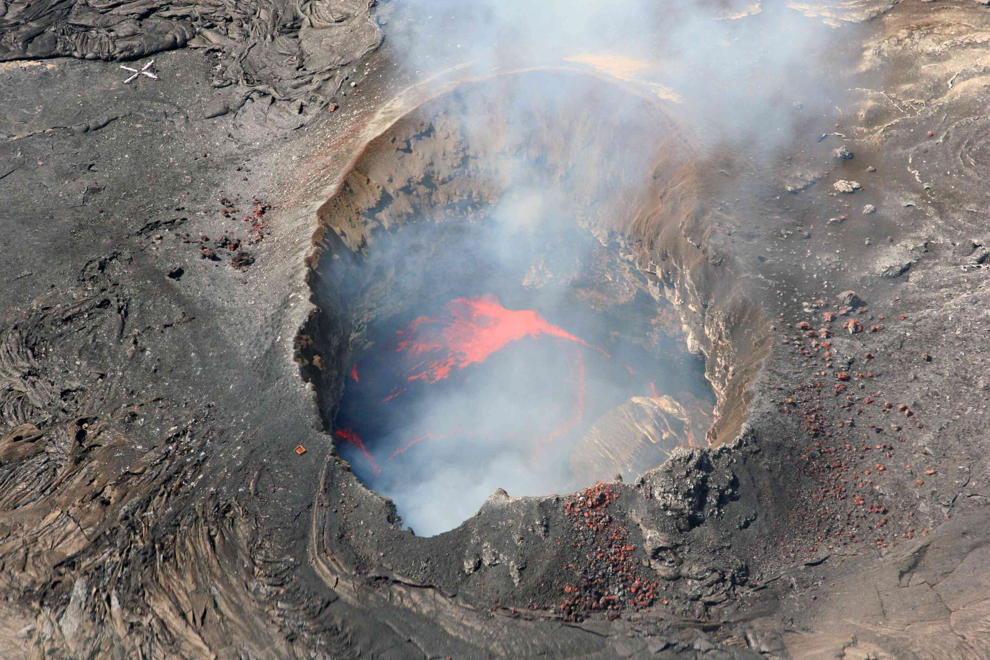 Overhead view of steaming, fiery vent on the Kilauea Volcano